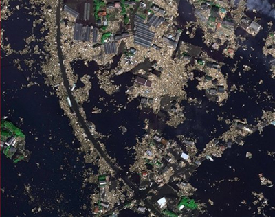 In this picture publicly provided by the German aerospace DLR and their crisis center on Monday March 14, 2011 the Japanese city of Sendai is pictured on Saturday March 12, 2011 after the earthquake and the following tsunami. (AP Photo/DLR ZKI)