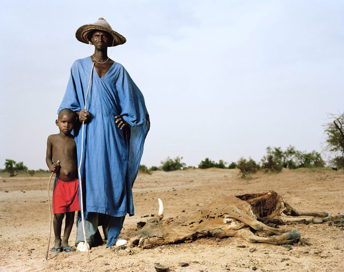 Gouro Modi, cow herdsman, with his son Dao. Korientze, Mali.