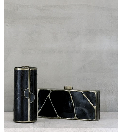 Black shell minaudiere with brass detail