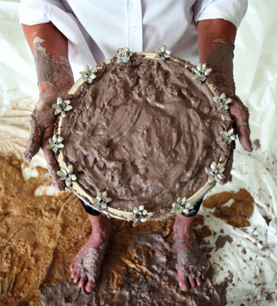 <em>Texas Mud Pie, Hands and Feet (self-portrait)</em>, 2012 C-print ©Rachel Lee Hovnavian